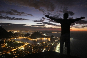 This is me greeting the sunrise atop  Pedra dos Dois Irmaos looking east toward Pao de Azucar.  Corcovado to the left. 6am